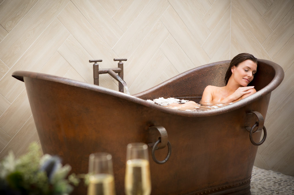 Relaxing soak in a copper tub.