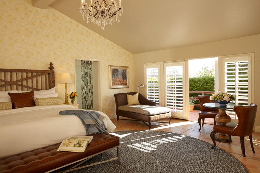 The Inn at Rancho Santa Fe guest room with sunlight streaming in.